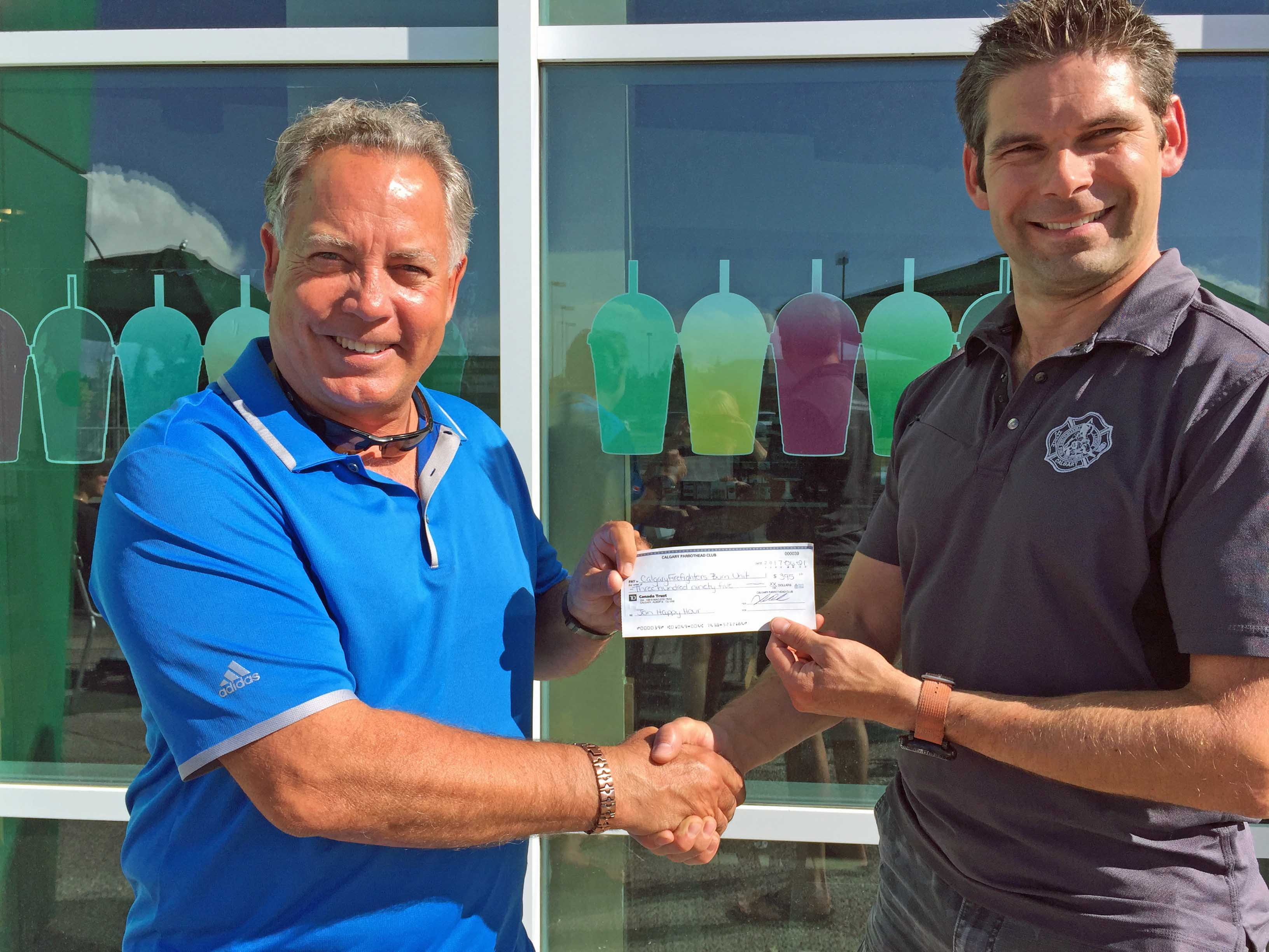 Cheque from Calgary Parrot Head Club to Fire Fighters Burn Treatment Society